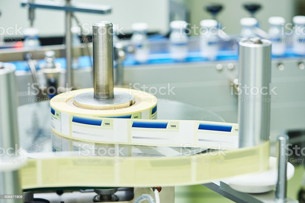 Lline conveyor for packaging ampoules in boxes stock photo