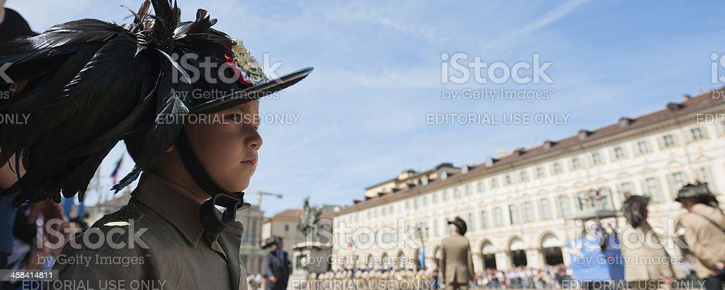 Llittle boy in italian sharpshooter uniform watching a national parade stock photo