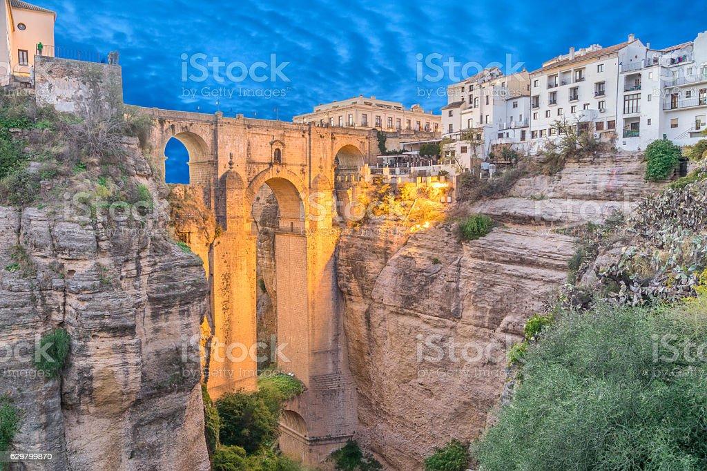 lluminated Puente Nuevo bridge in Ronda stock photo