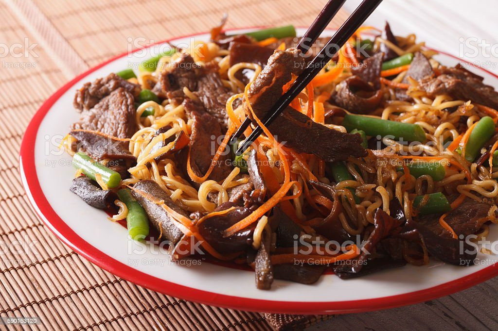 Lo mein noodles with beef and black fungus macro stock photo
