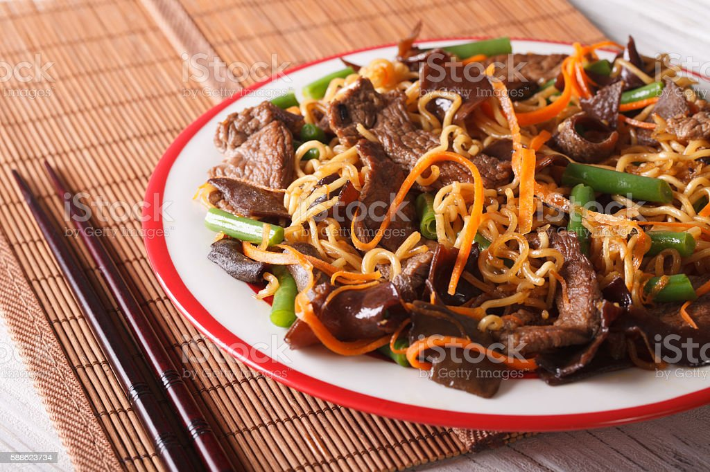 Lo mein with beef, muer and vegetables close-up. horizontal stock photo