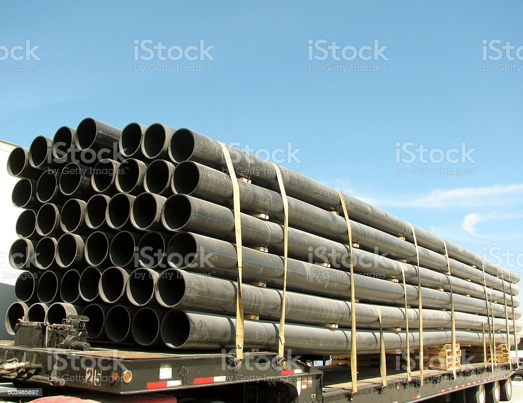 Load of black PVC pipes stock photo