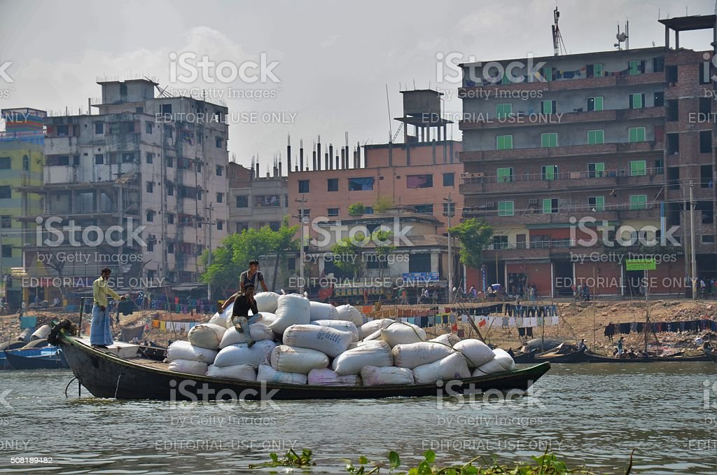 Loaded boat on a river in Dhaka stock photo