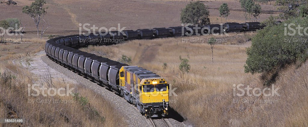 Loaded coal train heads to port royalty-free stock photo