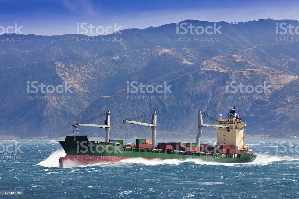 Loaded container freight ship in stormy sea royalty-free stock photo