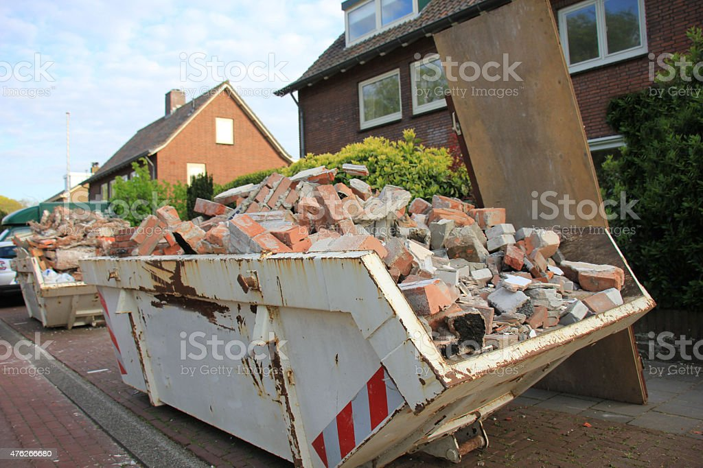Loaded dumpster stock photo