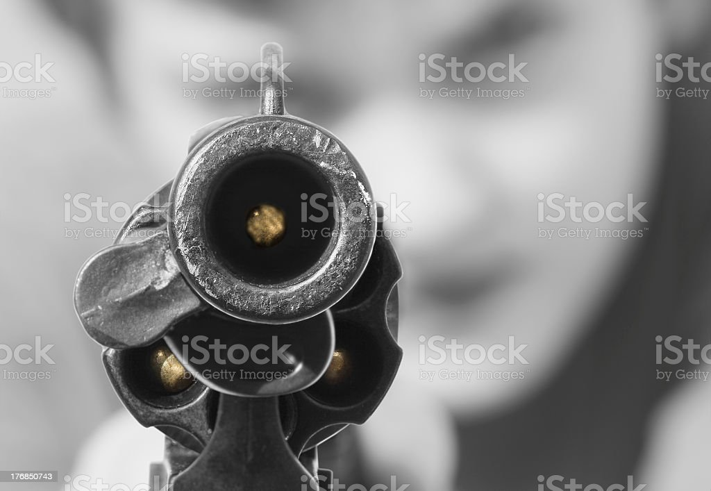 Loaded gun ready to be fired off stock photo
