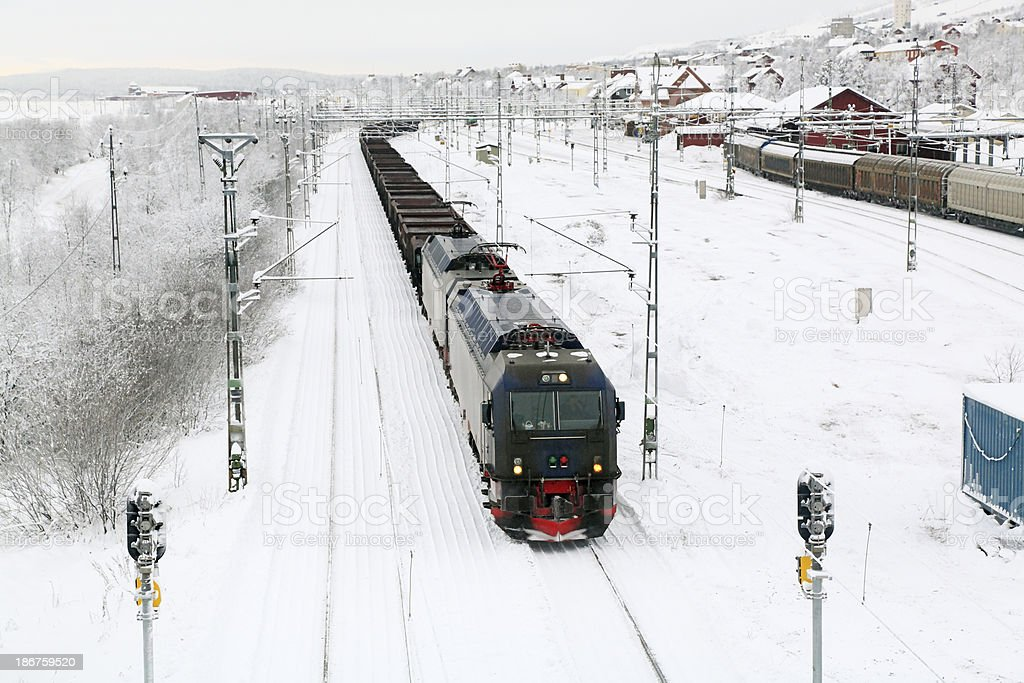 Loaded iron ore train in Arctic Circle snow royalty-free stock photo