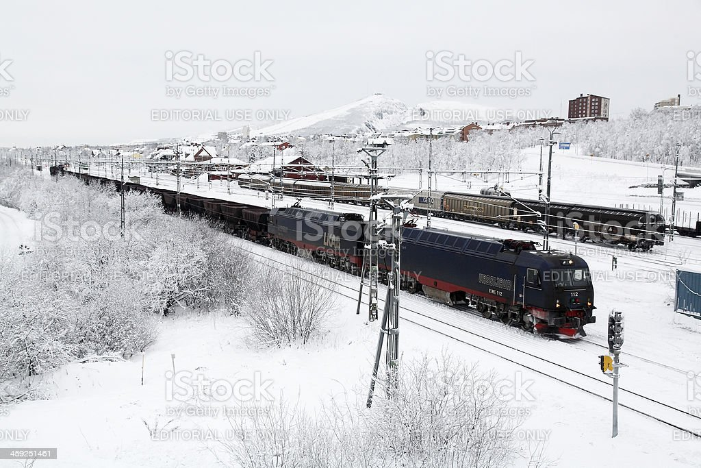 Loaded iron ore train in Arctic winter snow stock photo