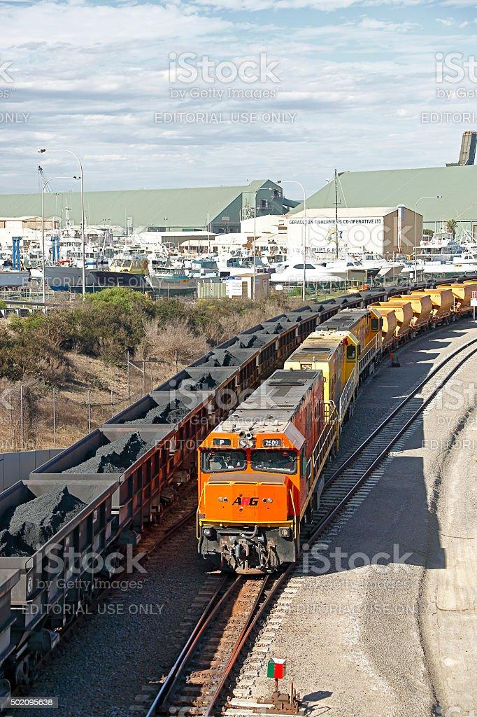 Loaded Karara iron ore train arriving Geraldton passing empty stock photo