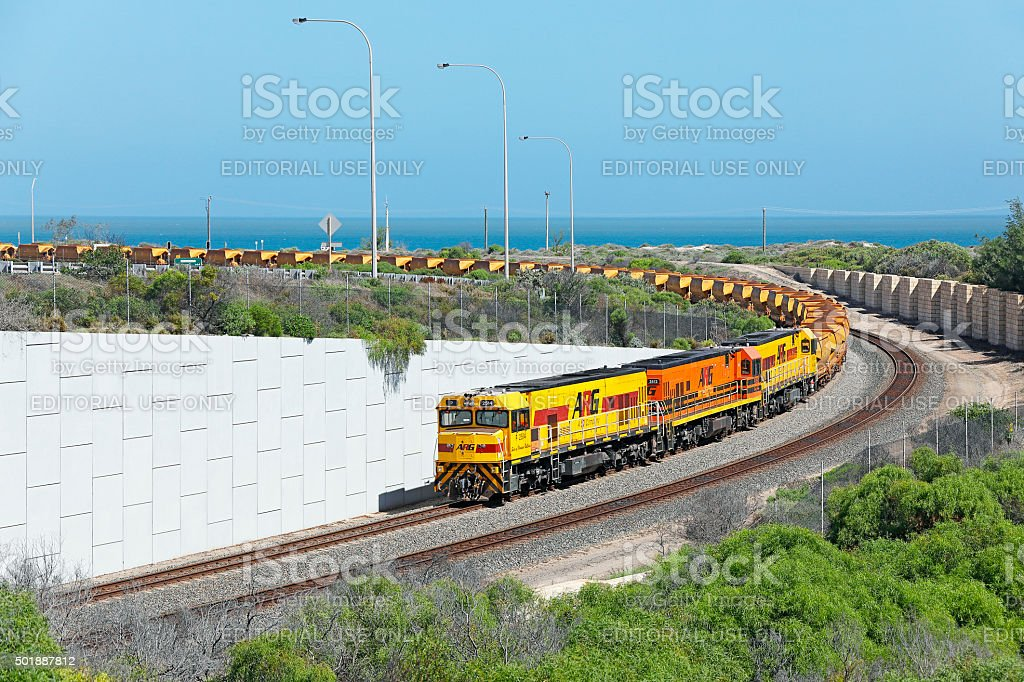 Loaded Mount Gibson iron ore train arrives at Geraldton Port stock photo