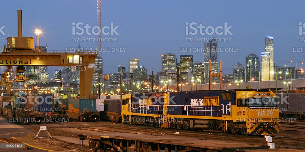 Loaded Pacific National freight train at night in city terminal stock photo