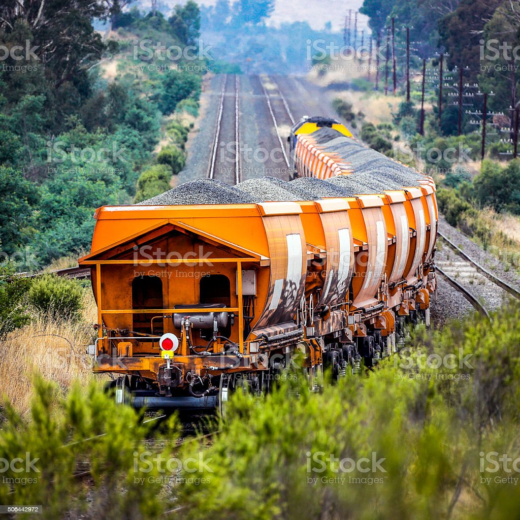 Loaded stone train in rural countryside stock photo