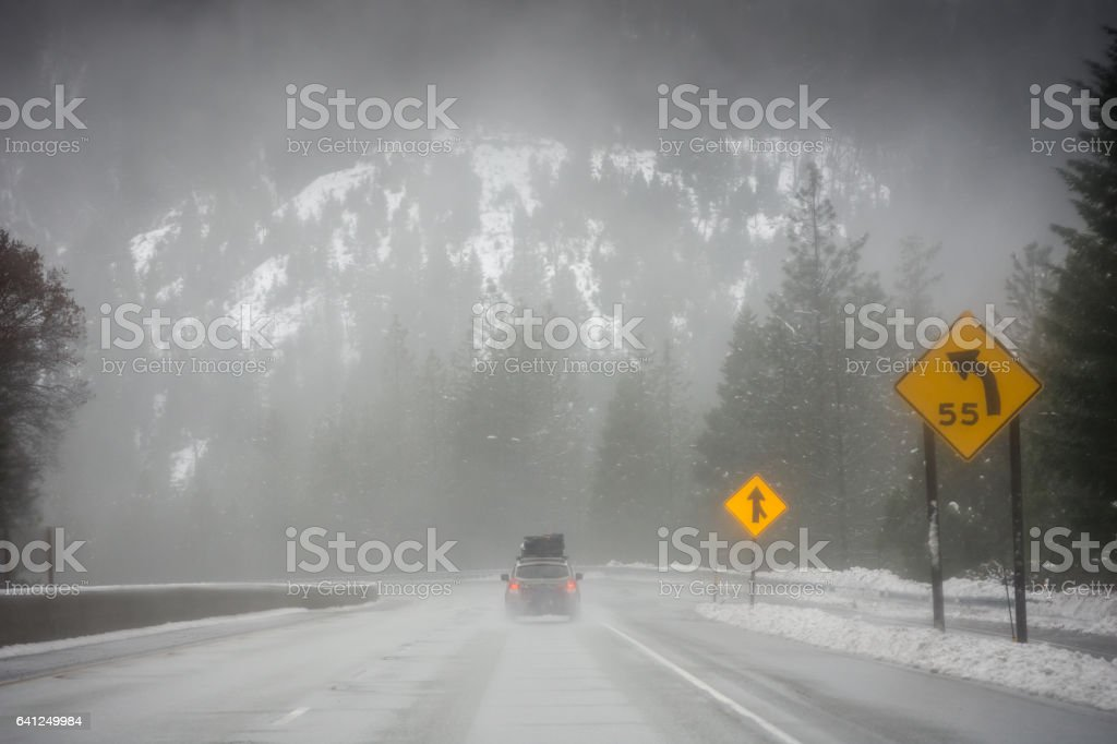 Loaded up family car on snowy Pacific Northwest road trip stock photo