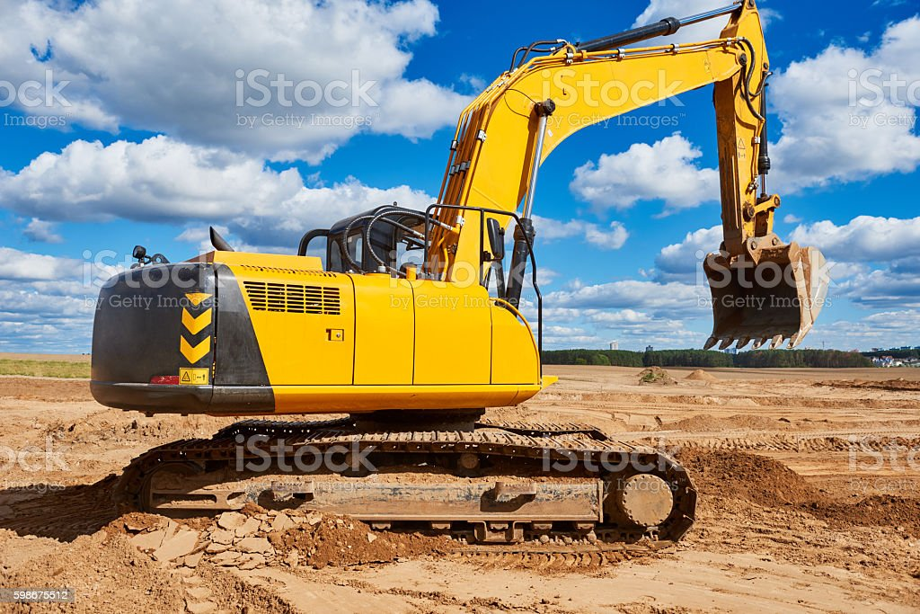 Loader excavator at sandpit during earthmoving works stock photo