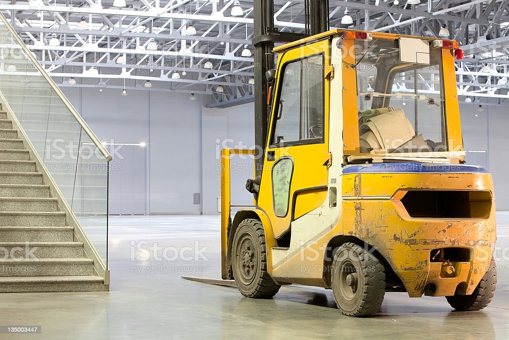 Loader in modern storehouse royalty-free stock photo