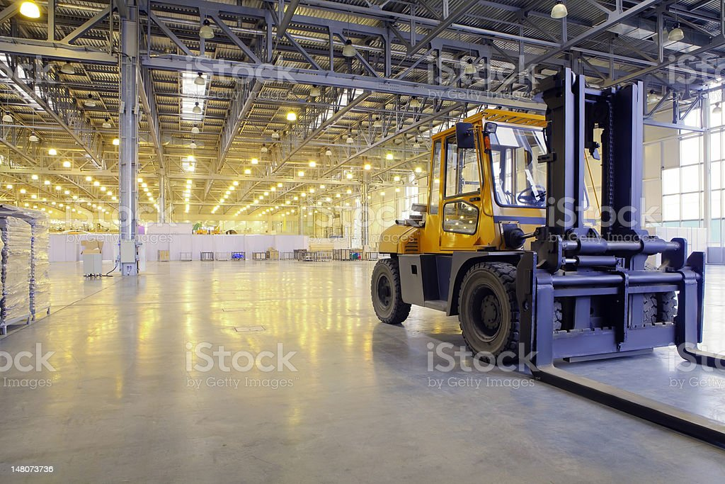 Loader in modern storehouse stock photo