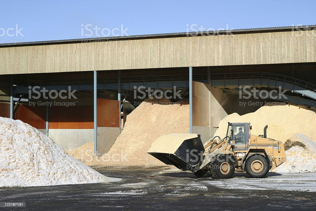 loader moving sawdust royalty-free stock photo