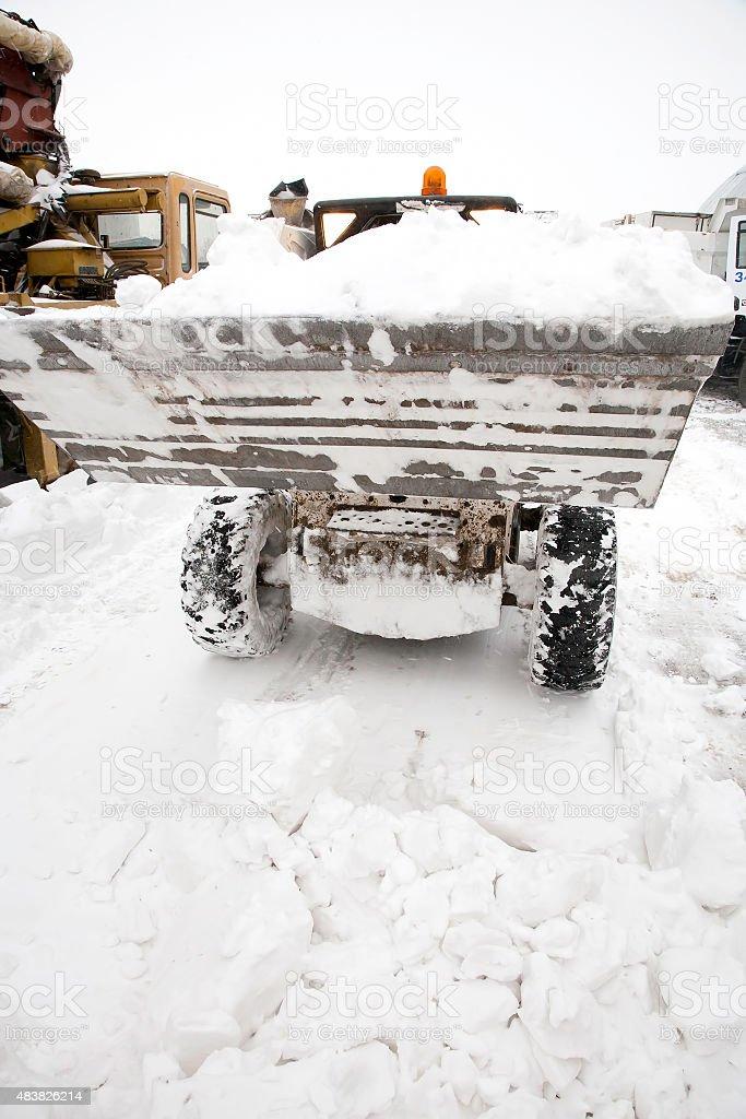 Loader on snow stock photo