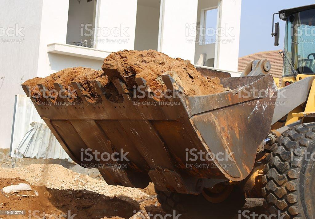 Loader Rock Bucket stock photo
