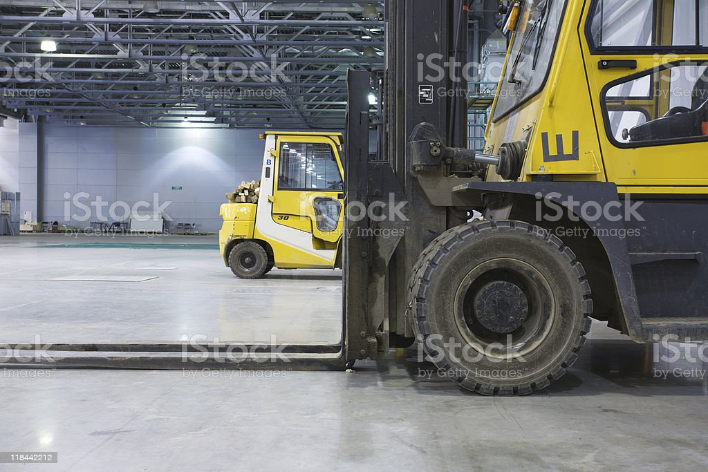 Loaders in modern storehouse stock photo