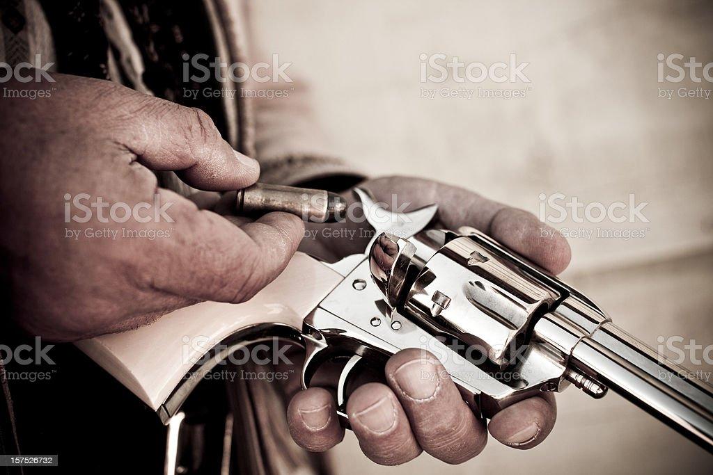 Loading a gun royalty-free stock photo