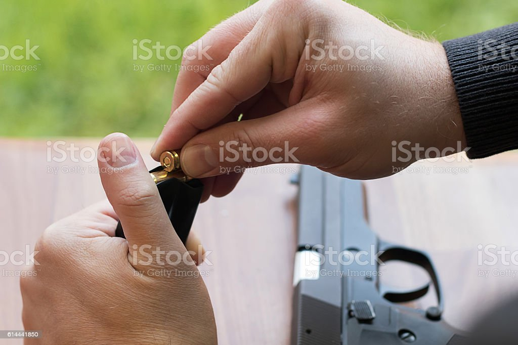 Loading a magazine. Loading Gun. Handgun magazine, stock photo