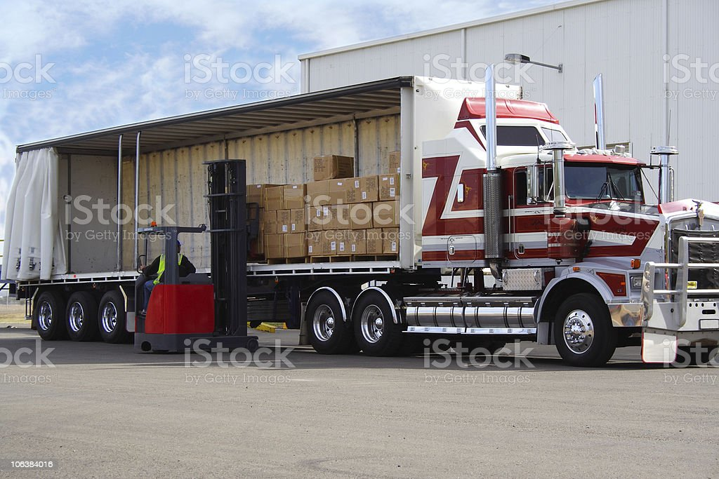 Loading a semi with boxes using a forklift stock photo