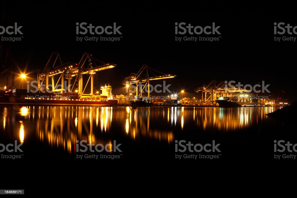Loading and unloading of cargo ships stock photo