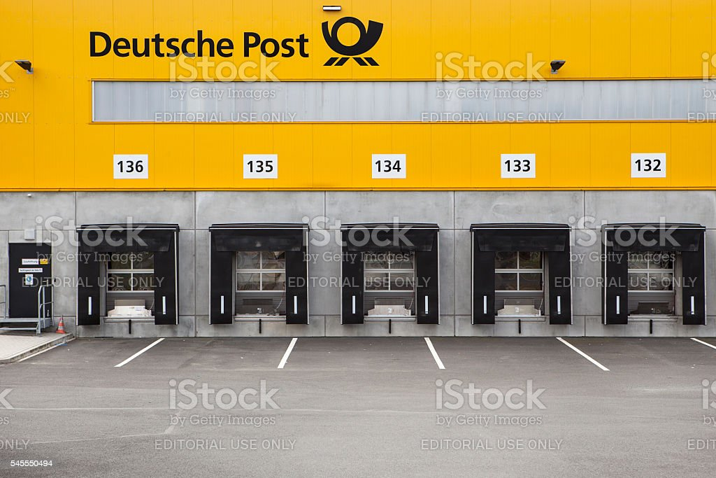 Loading bays, distribution hub of parcel service Deutsche Post a stock photo