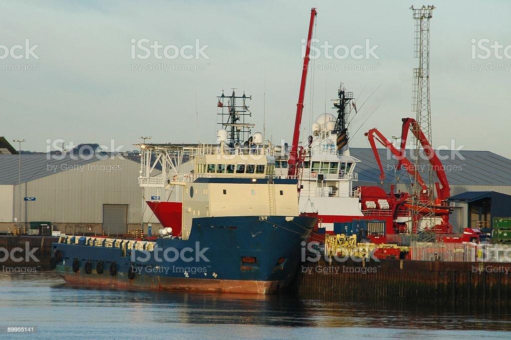 Loading cargo at harbor royalty-free stock photo
