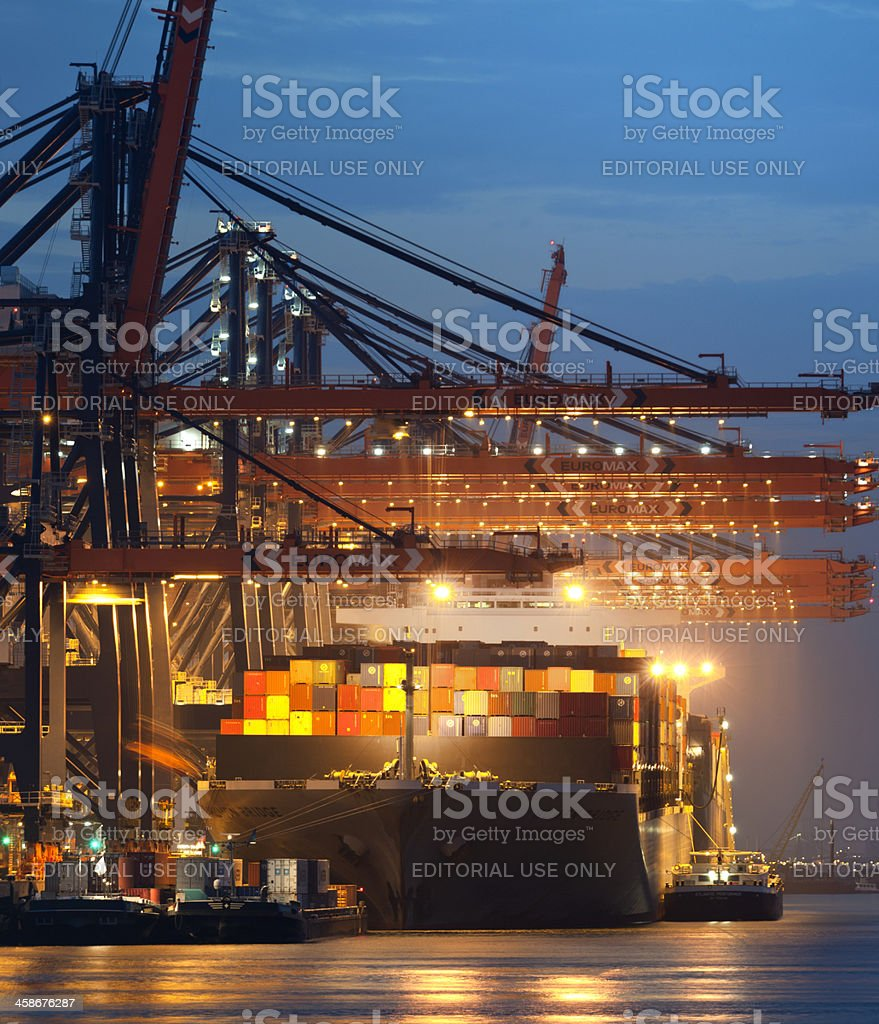 loading cargo container ship in commercial dock at night royalty-free stock photo