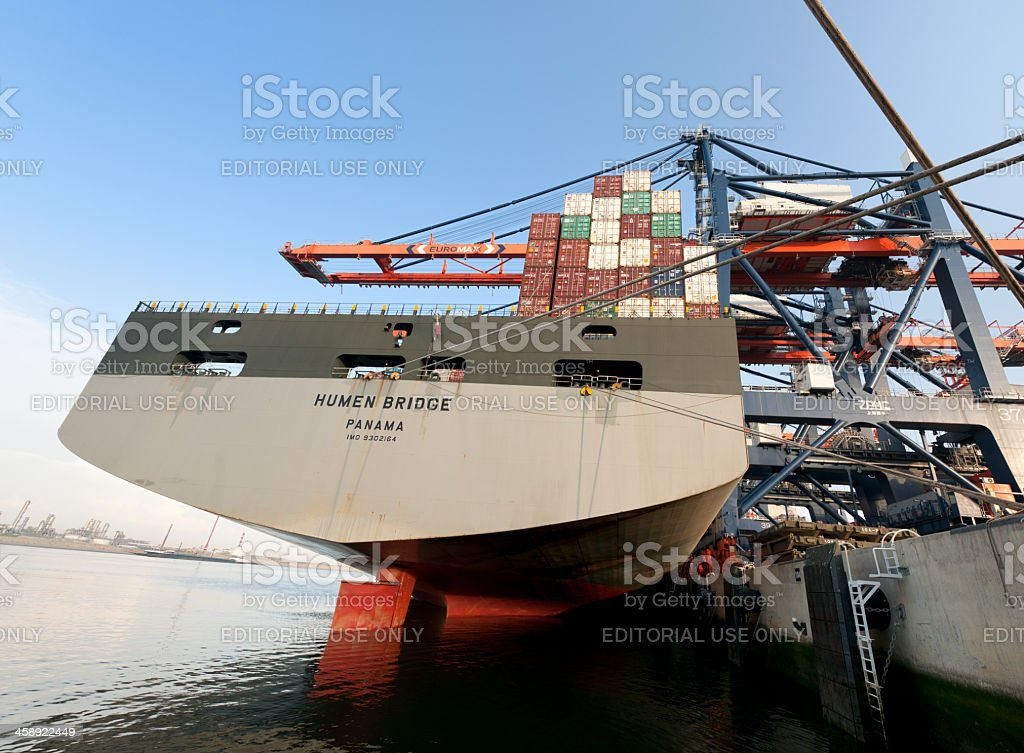 loading cargo container ship moored in harbour stock photo