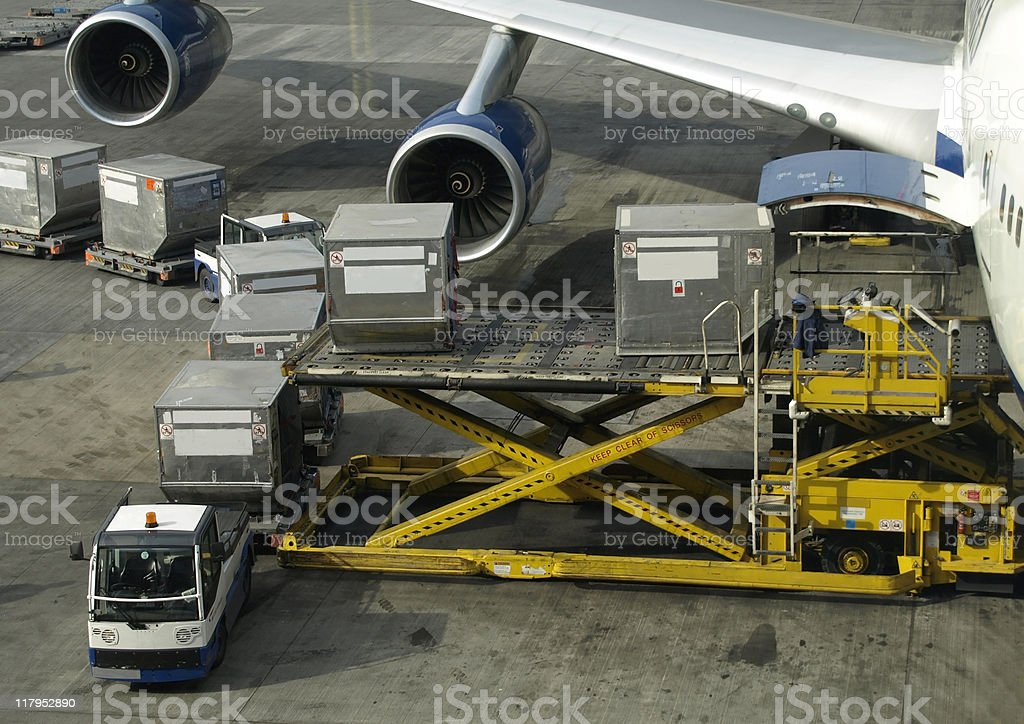 Loading cargo into a Boeing 747 royalty-free stock photo