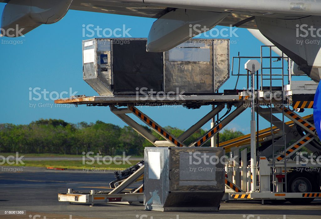 Loading cargo into a plane - Unit Load Device stock photo