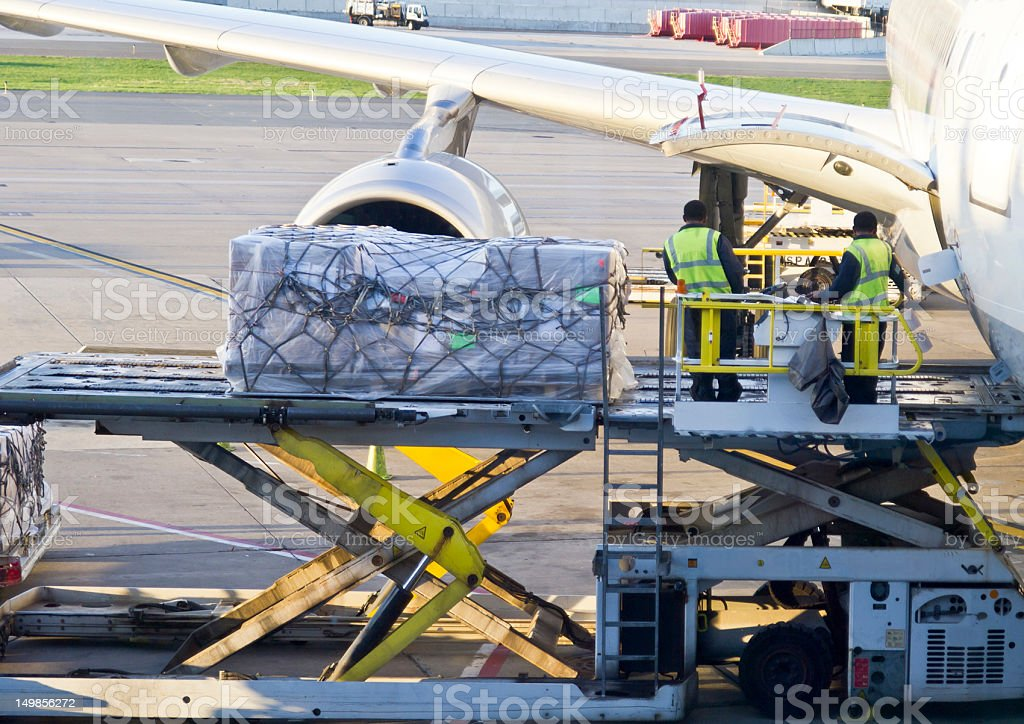 Loading Cargo into an Airbus 330 stock photo