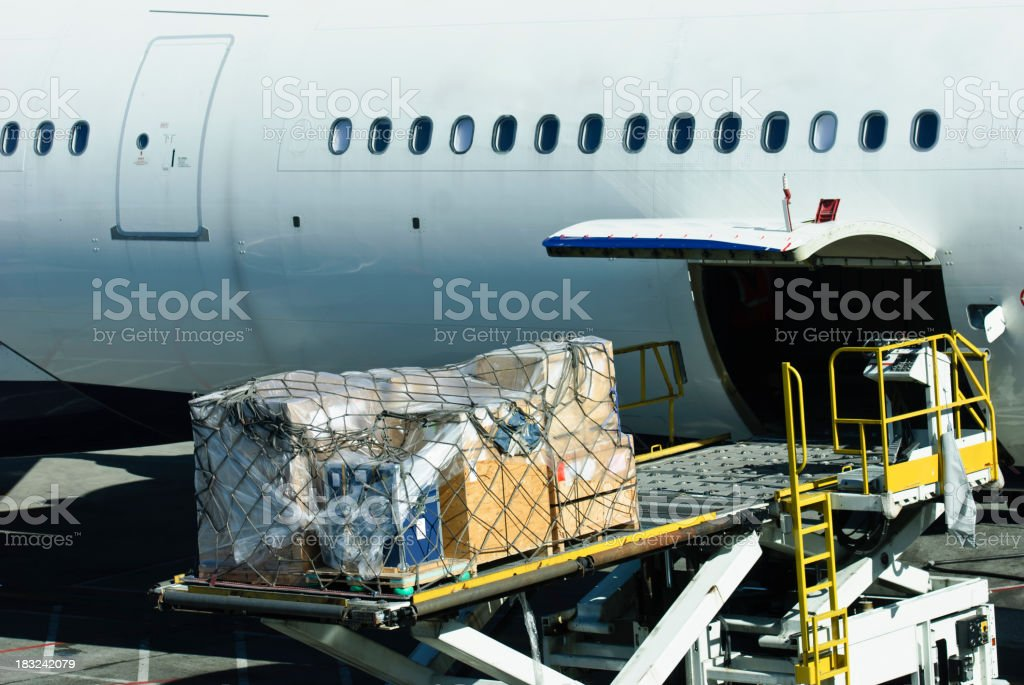 loading cargo into plane stock photo
