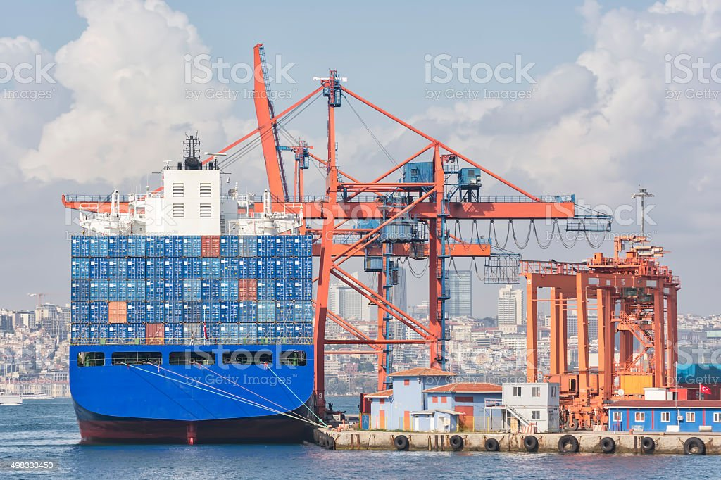 Loading Cargo On A Container Ship stock photo