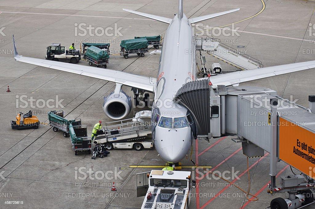 Loading cargo to airplane royalty-free stock photo