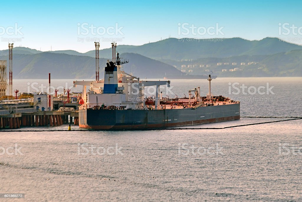loading chemical tankers in the port stock photo