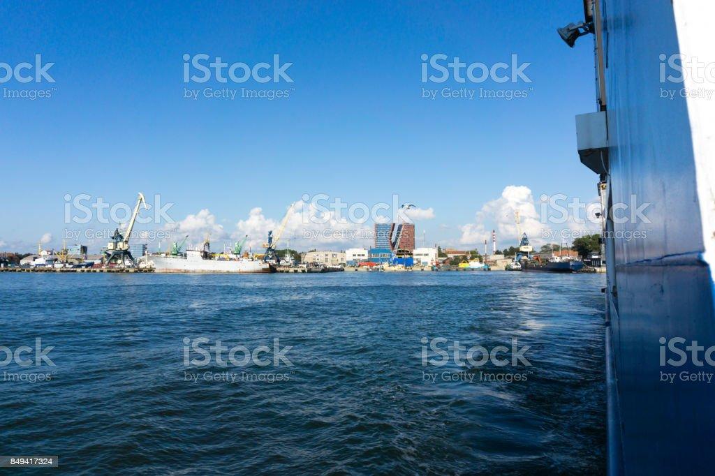 Loading cranes and ship at Baltic sea in sea Port, Klaipeda, Lithuania. Sunset stock photo