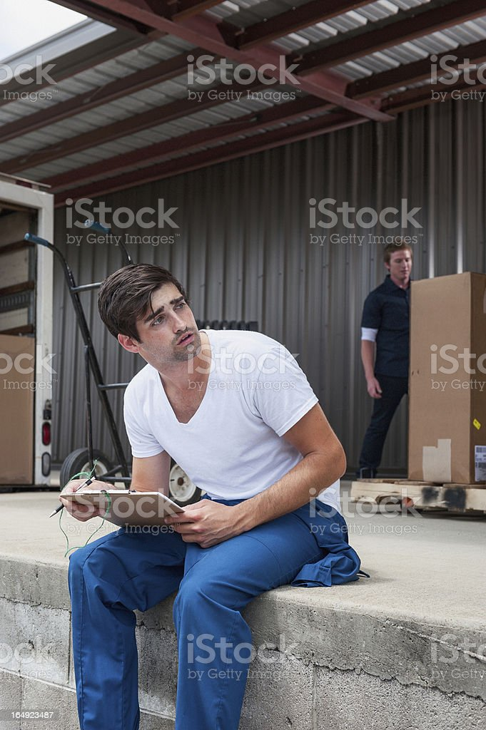 Loading Dock Worker Waiting On Delivery royalty-free stock photo