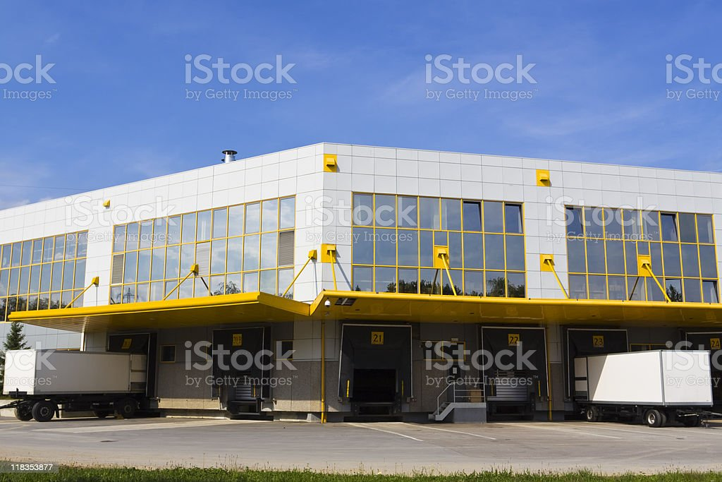 Loading docks with two trucks parked outside royalty-free stock photo