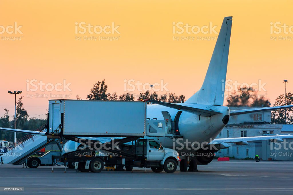 Loading food on a plane in the early morning royalty-free stock photo