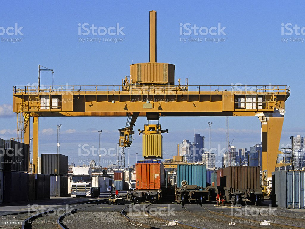Loading freight containers at city intermodal hub royalty-free stock photo