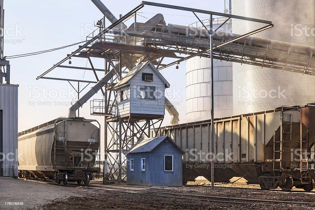 Loading grain into railroad cars stock photo