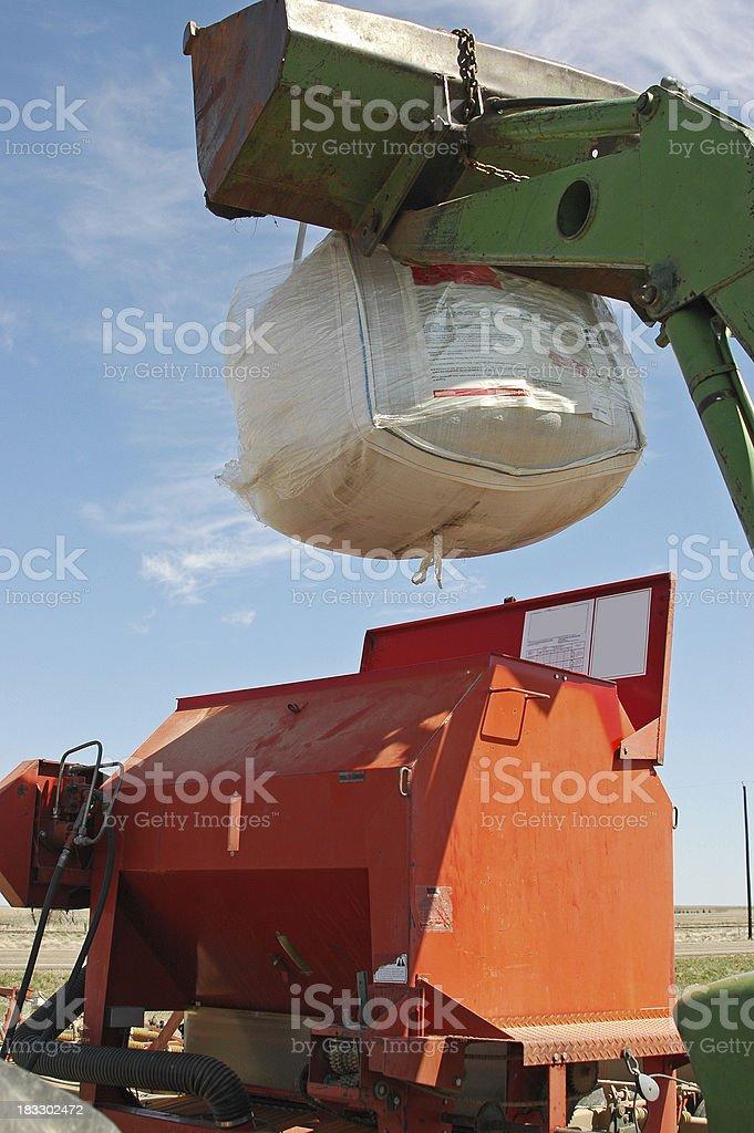 Loading granular product in spreader stock photo