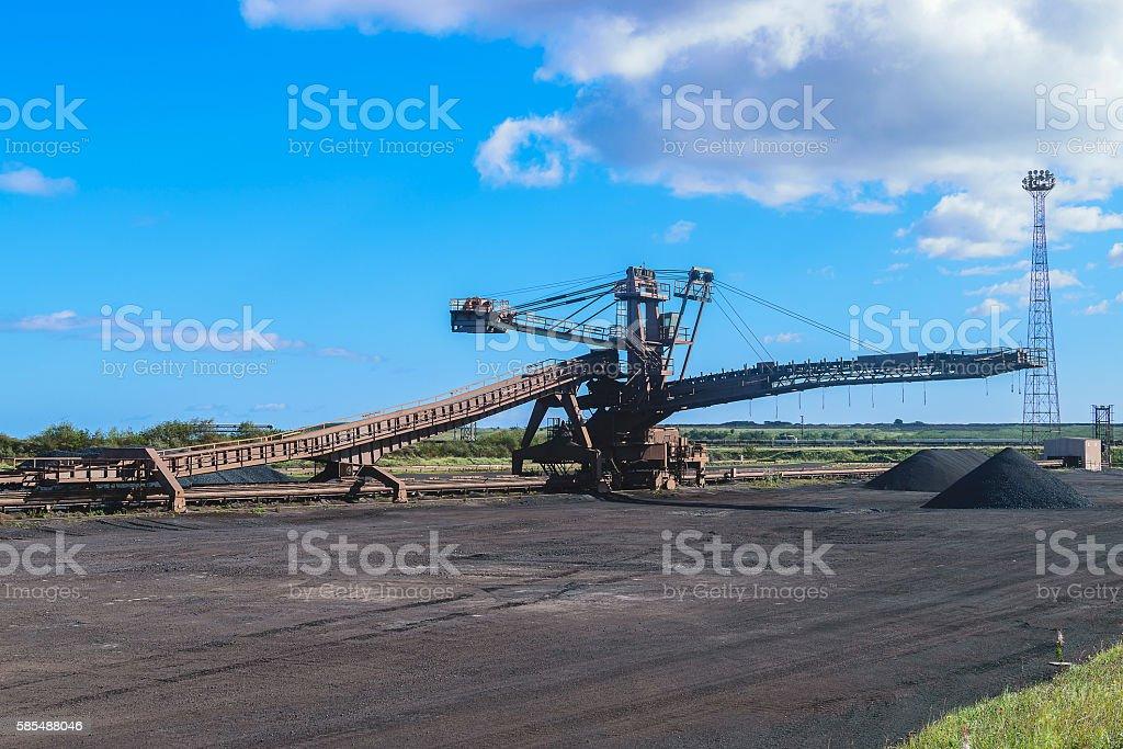 Loading iron ore conveyor machine in steel industry, UK stock photo