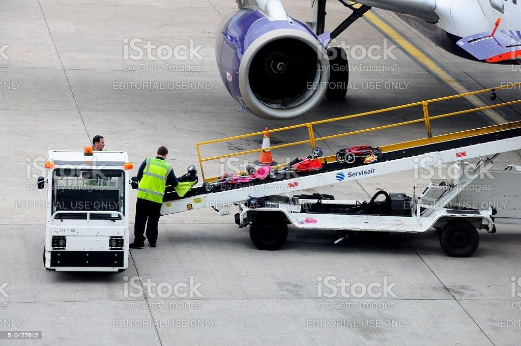 Loading luggage onto an aeroplane, Birmingham. stock photo