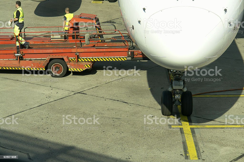 Loading Luggage onto an Aircraft royalty-free stock photo